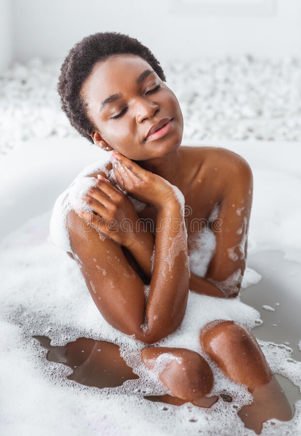 Free Pleasure And Cleanliness. African American Girl With Closed Eyes Takes Bath With Foam Royalty Free Stock Photo - 194483635