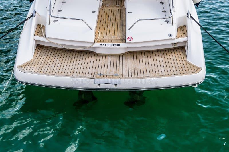 Pleasure boat deck. Modern pleasure boat deck. Wooden surface of deck. Maximum 8 people on a board of vessel. Waters of bay in Golden Sands resort. Black Sea stock images
