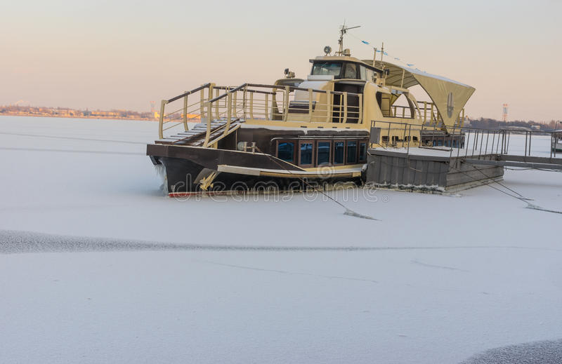 Pleasure boat frozen in on a Dnepr river. In center of Dnepropetrovsk city stock photos