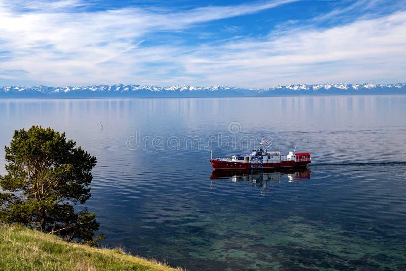 Pleasure boat on lake Baikal royalty free stock photos