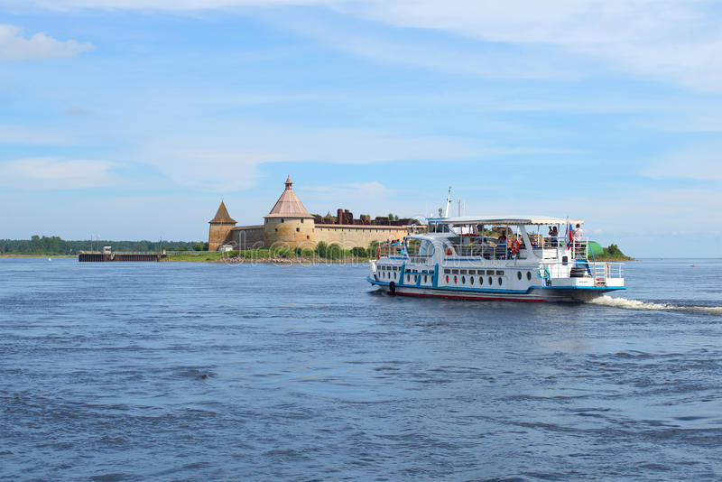 Pleasure boat Millenium-1 floats to the fortress Oreshek. Shlisselburg, Leningrad region. SHLISSELBURG, RUSSIA - AUGUST 01, 2016:: Pleasure boat Millenium-1 royalty free stock photos