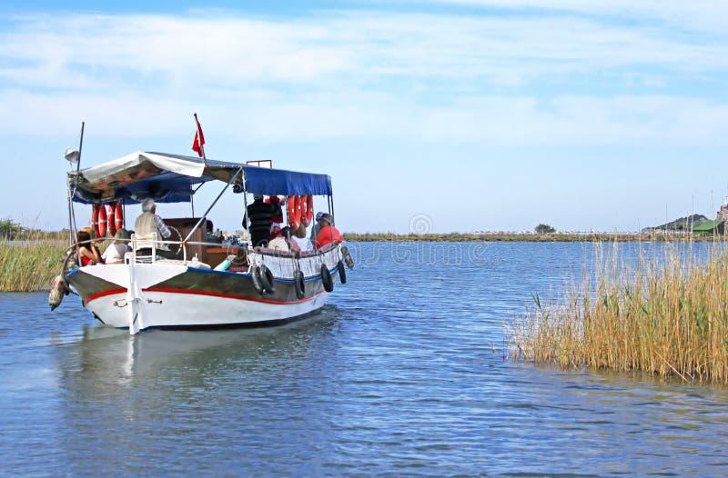 Pleasure boat motor up the Dalyan river, Turkey stock photos