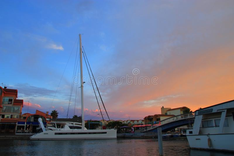 Pleasure boat and port of Gruissan at sunset in the Aude, France royalty free stock photos
