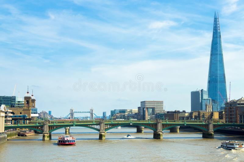 Pleasure boat on the River Thames with Shard in the background, London royalty free stock image