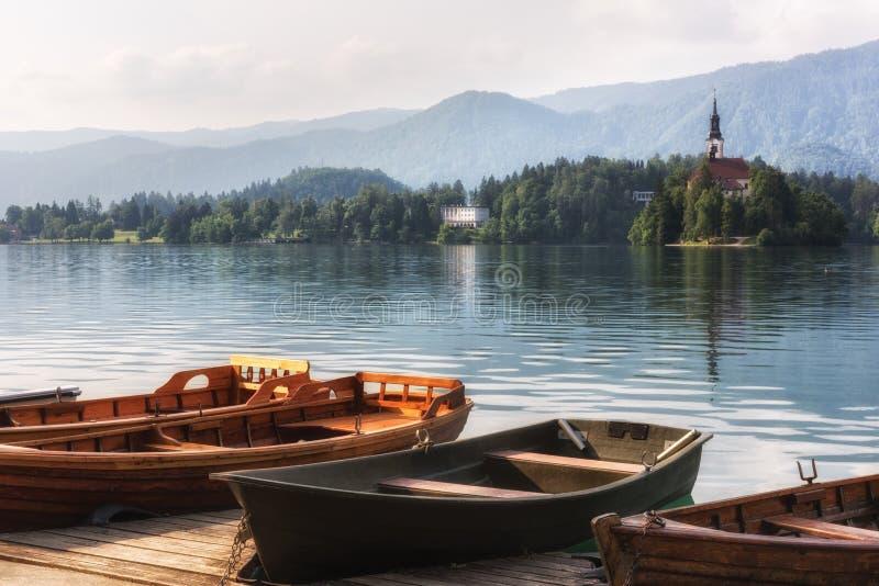 Pleasure boats on the beautiful alpine lake Bled, Slovenia royalty free stock image