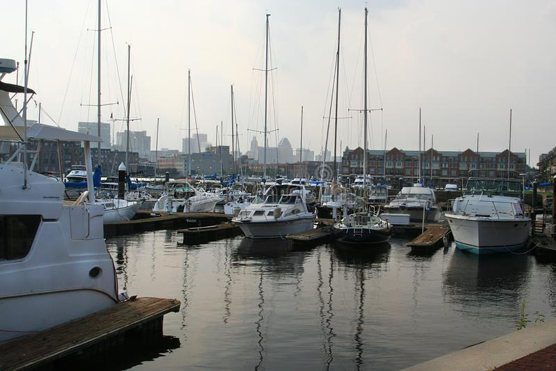 Pleasure boats docked in Baltimore harbor on a summer evening stock images