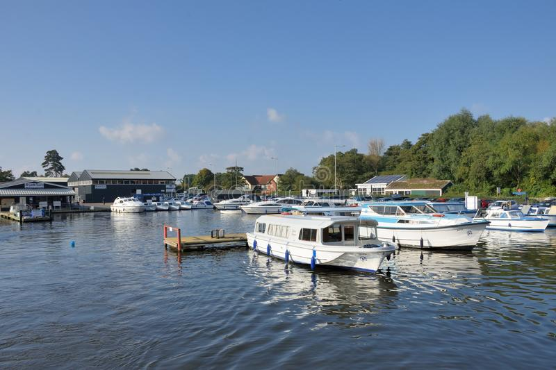 Pleasure Boats on River Yare centre for tourism on Norfolk Broads. Wroxham Norfolk , United Kingdom - October 25, 2016: Pleasure Boats on River Yare centre for royalty free stock images