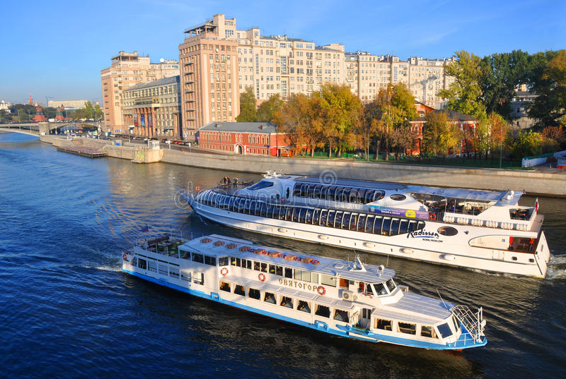 Pleasure boats `Svyatogor` and `Beauty` near a residential Government House. Moscow, Russia. Two of the ship go to meet royalty free stock image
