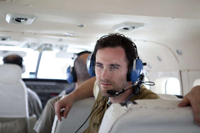 The pleasure of the flight. A man is enjoying the flight on a Cessna stock photos