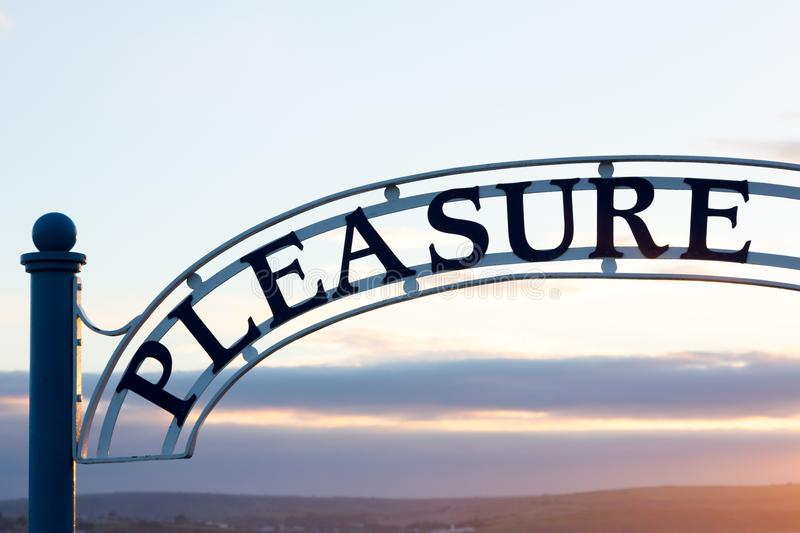 Pleasure sign over Pleasure Pier entrance in Weymouth, UK stock images