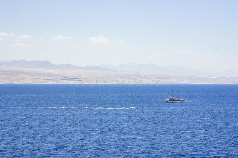 Pleasure yacht in the Red Sea against the mountains.  royalty free stock image