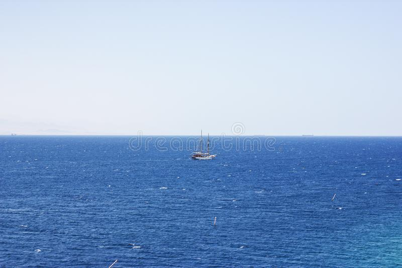 Pleasure yacht in the Red Sea against the mountains.  royalty free stock photos