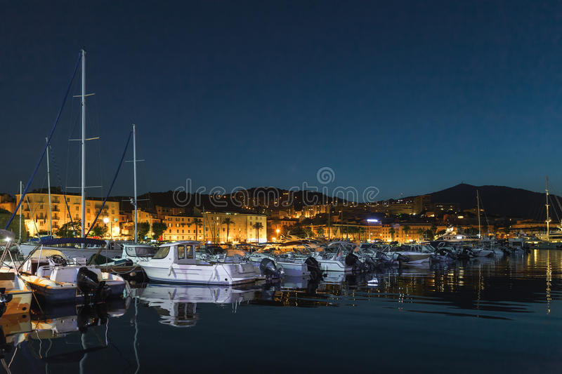 Pleasure yachts and motor boats, Ajaccio port. Pleasure yachts and motor boats moored in old port of Ajaccio, the capital of Corsica island, France. Dark night royalty free stock images