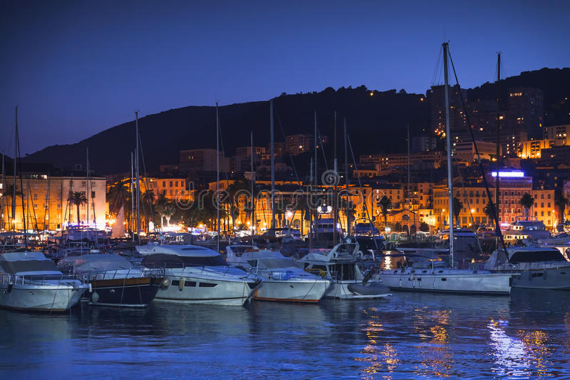 Pleasure yachts and motor boats at night. Pleasure yachts and motor boats moored in old port of Ajaccio, Corsica island, France. Dark night photo stock photos