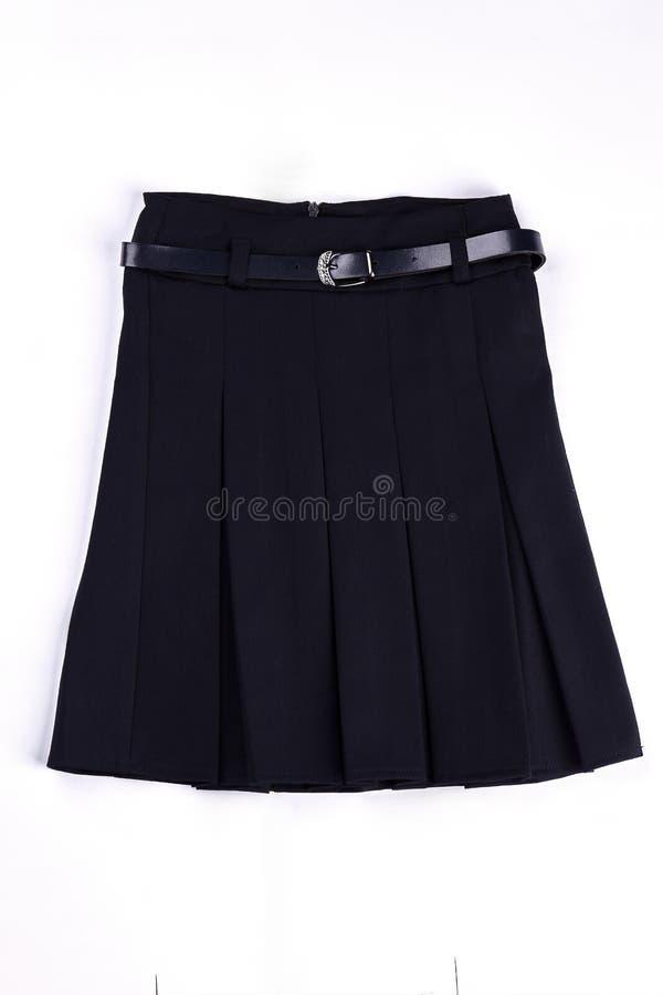 Pleated black uniform skirt isolated. royalty free stock photography