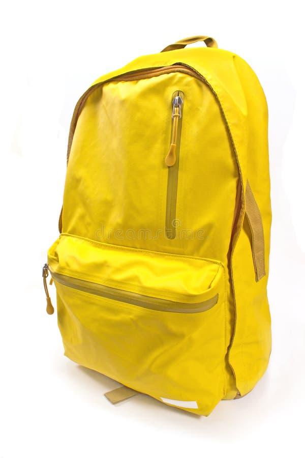 Plecaka kolor żółty odizolowywający na bielu zdjęcie royalty free