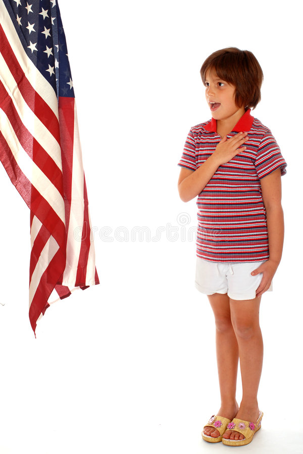 Pledge of Allegiance. Young elementary girl in casual wear saying the pledge of allegiance to the American flag. Isolated on white stock photography
