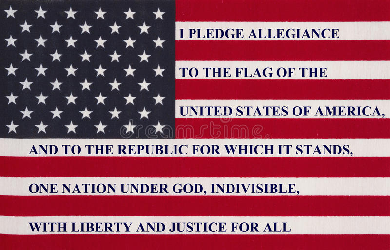 The pledge of allegiance on a flag. The pledge of allegiance written on the United States of America flag stock photo