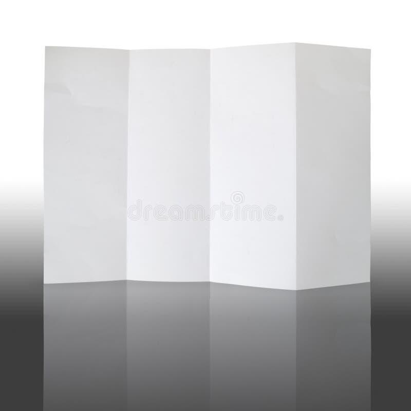 Plegable el Libro Blanco y refleje imagen de archivo