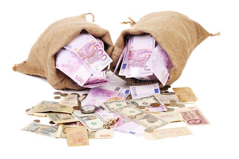 Plein sac deux avec l'argent. photos stock