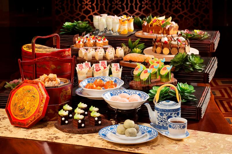 Plenty of cake and tea for mid autumn festival in asia stock photos