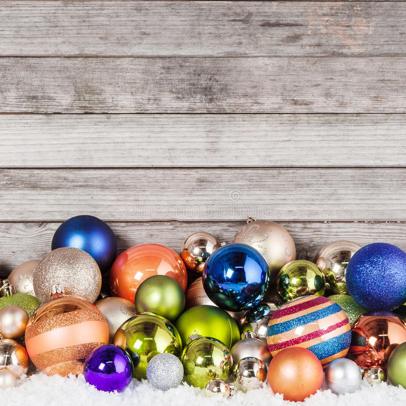 Plenty of Christmas Balls on Wooden Background royalty free stock photography