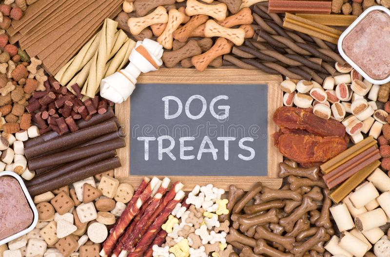 Plenty of dog treats, top view. Plenty of dog treats, kibble and other food for pets, top view royalty free stock photo