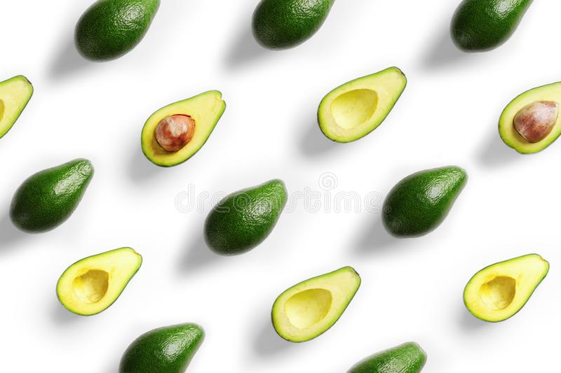 Plenty of fresh avocados on white background royalty free stock image