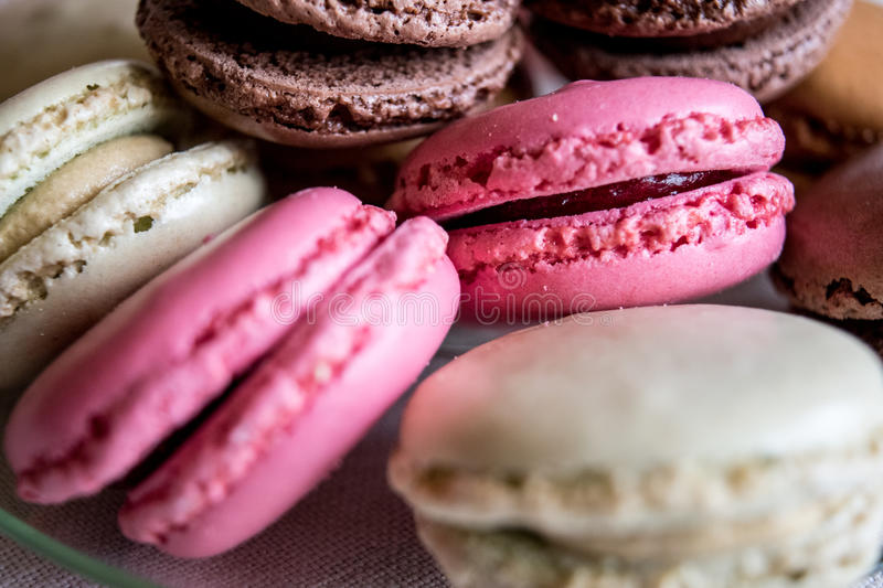 Plenty of lovely colored macarons macro royalty free stock photography