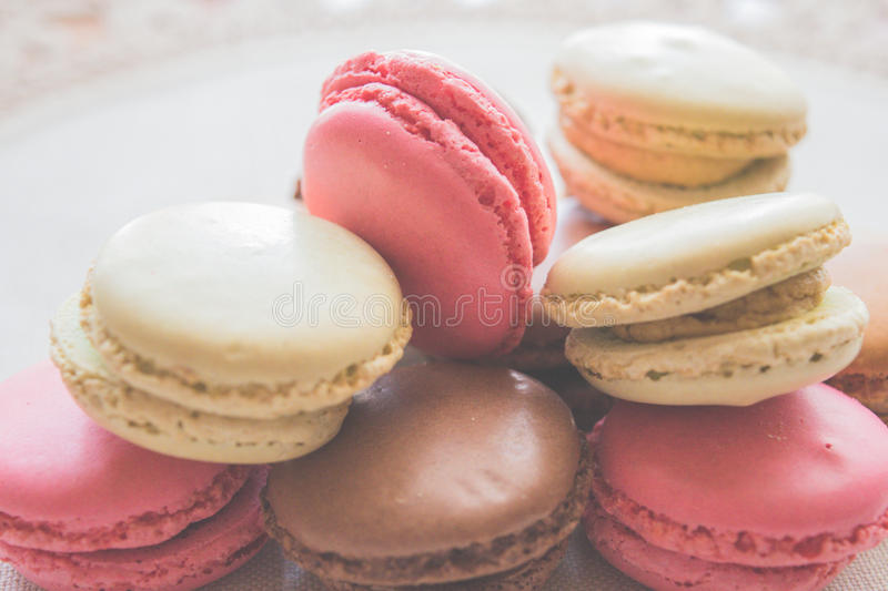Plenty of lovely colored macarons stock images