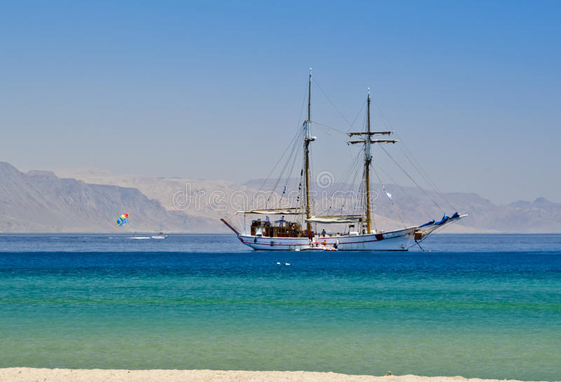Pleusure yacht near a beach in Eilat, Israel. Eilat is a famous resort city in Israel royalty free stock photography