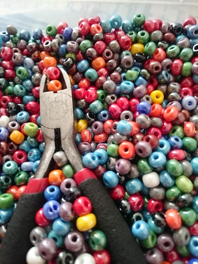 Pliers and beads stock images