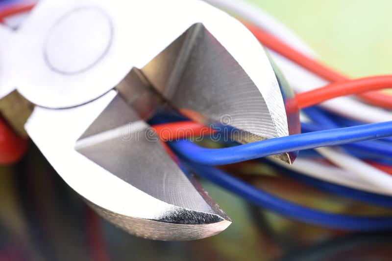 Pliers cutting electrical wires royalty free stock image