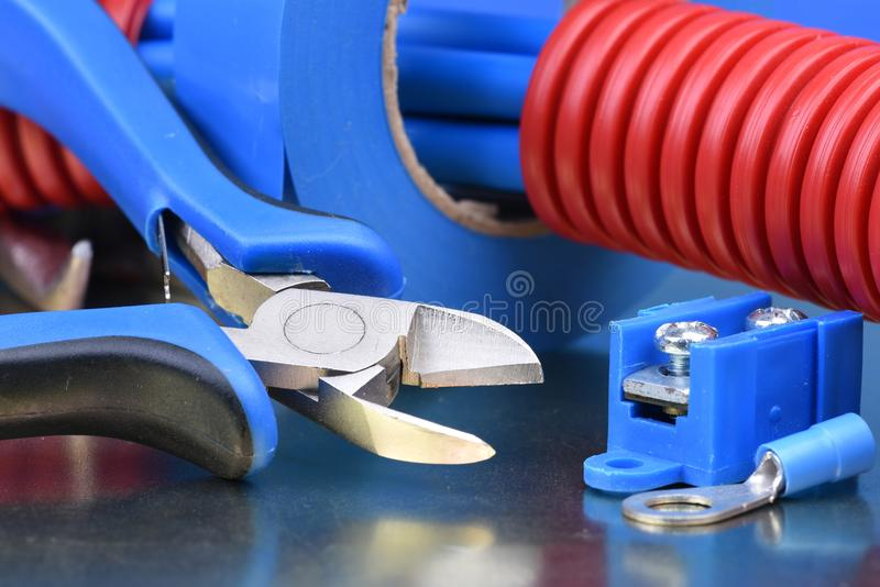 Pliers cutting electrical wires stock image