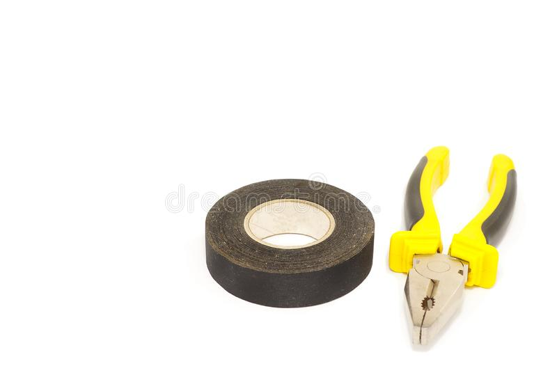 Pliers and electrical tape. royalty free stock images