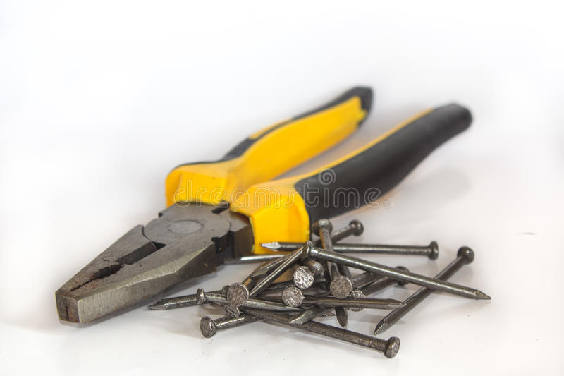 Pliers and nail royalty free stock photo