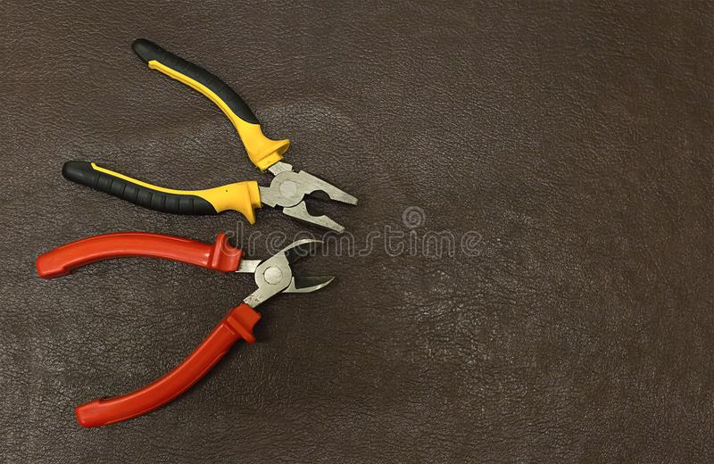 Pliers pair tools base wire repair wires background manufacturing on a dark background copy spase royalty free stock photos