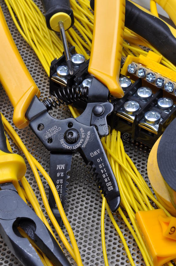 Pliers strippers with electrical component kit. On metal surface royalty free stock images