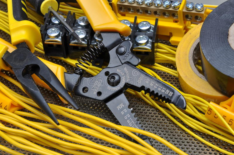 Pliers strippers with electrical component kit. On metal surface stock images