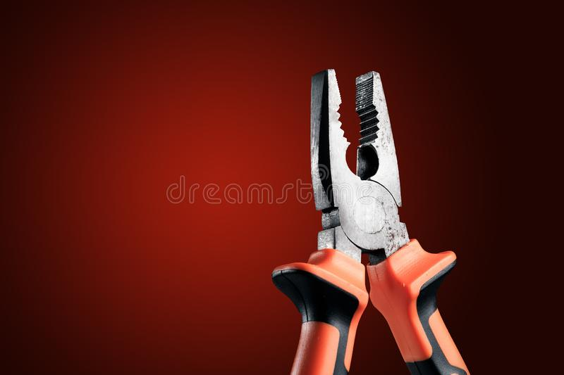 Pliers, tool for repairing and renovation concept on black background top view. working instruments for repairing and fixing, flat. Lay, copy space royalty free stock image
