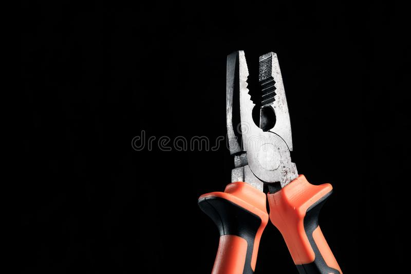 Pliers, tool for repairing and renovation concept on black background top view. working instruments for repairing and fixing, flat. Lay, copy space stock photo