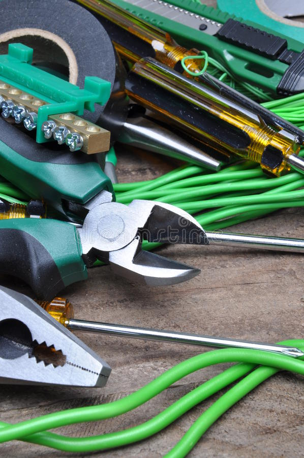 Pliers tools and component for electrical installation. On wooden board royalty free stock photos