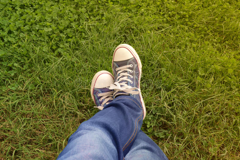 Plimsolls on the grass stock images