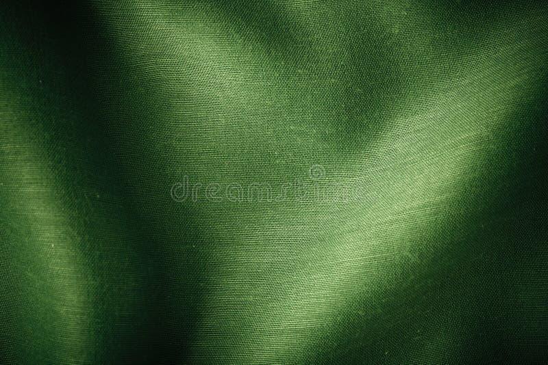 Plis onduleux fond de tissu vert d'abrégé sur de texture de textile photo libre de droits