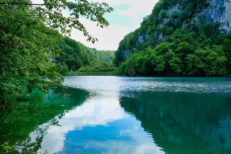 Clouds and Blue Sky Reflected in Plitvice Lake, Croatia royalty free stock photography