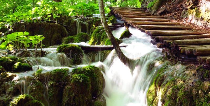 Plitvice lake, wooden bridge with waterfall stock photos