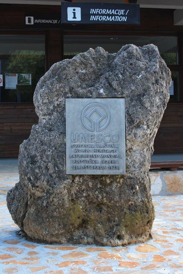 Plitvice lakes, Croatia, Monumental rock with UNESCO plaque stock photography
