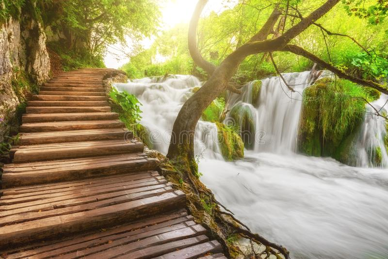 Plitvice Lakes National Park, tourist route on the wooden flooring along the waterfall, Croatia stock photos