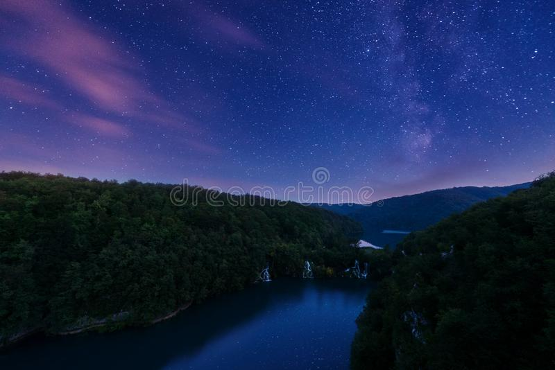 Plitvice Lakes National Park waterfalls at night, nature landscape. Plitvice Lakes National Park waterfalls at night, amazing image with Milky Way and beautiful stock photo