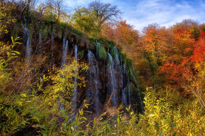 Plitvice lakes Plitvicka jezera national park, Croatia. Amazing autumn sunny landscape. With waterfall, colored trees and blue sky, Prstavac. Outdoor travel stock images